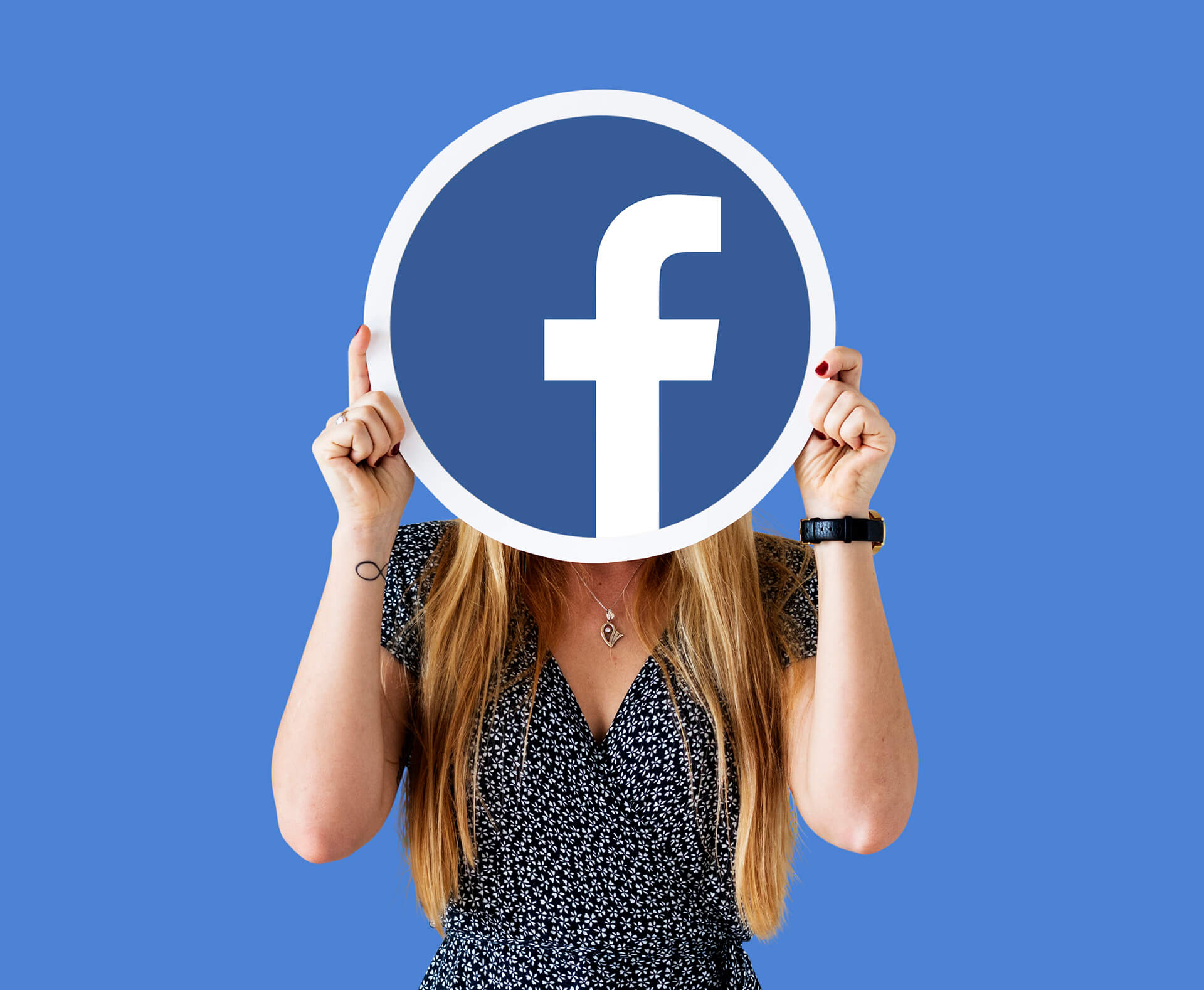 woman showing facebook icon 1