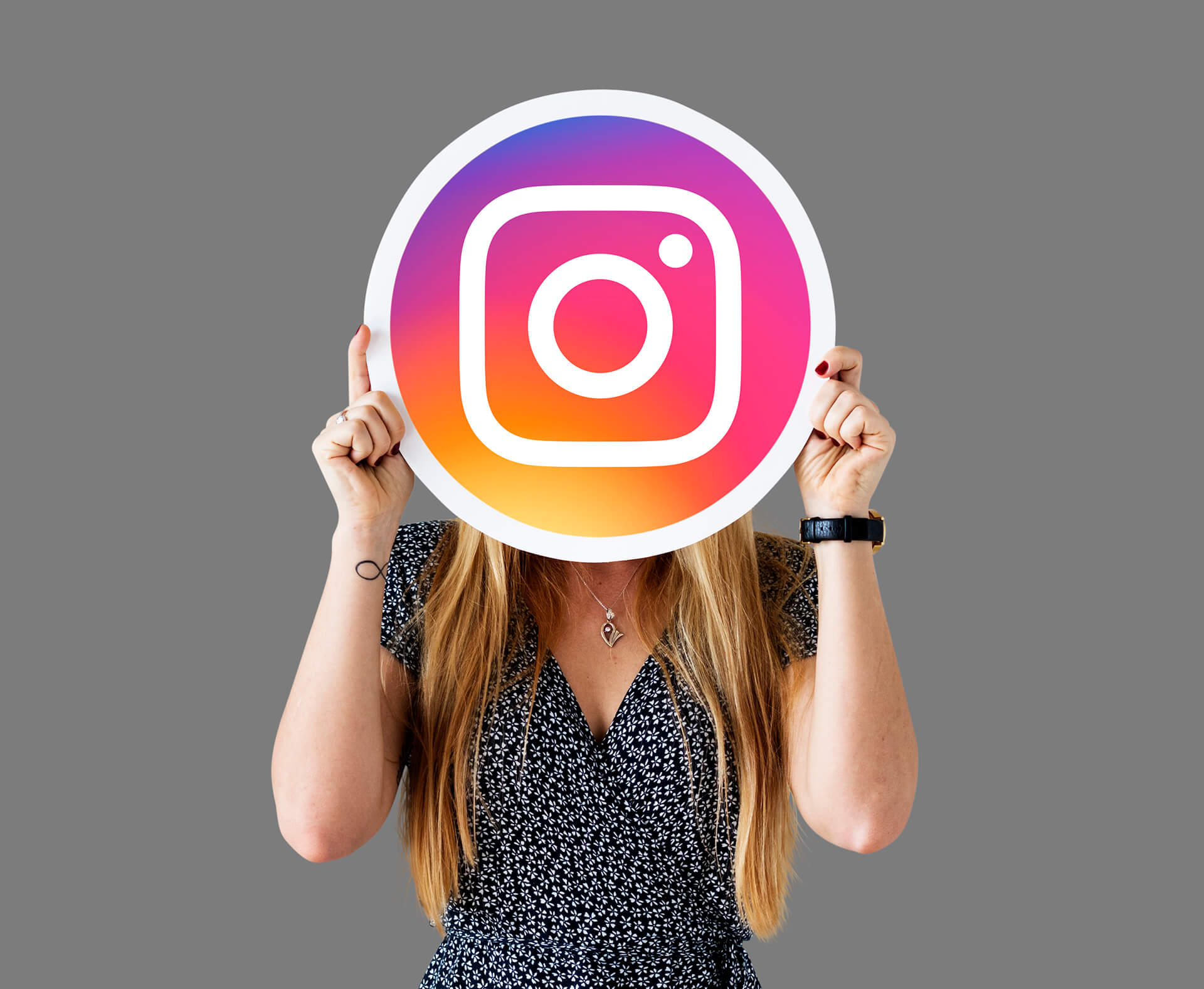 woman showing instagram icon 1